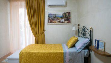 stanza-da-letto-camera-doppia-con-letti-singoli